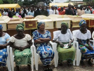 Widows and coffins of their husbands slain by suspected Islamic extremists Sept. 16, 2012, in Bauchi, Nigeria.