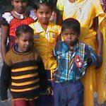 Widow and children of Baishakhu Pahari, who was killed by Hindu extremists. (Morning Star News photo)