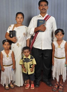 Pastor Mallik Arjun, beaten by Hindu extremists in Karnataka, India, and his family.