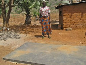 Alice Saul at the grave of her son, Felix Saul, killed at age 22 by the suspected Fulani Muslim gunmen.