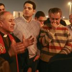 Clergymen and fellow Christians prayed and sang outside Cairo's airport after Atallah's body arrived Tuesday night (March 12). (Morning Star News photo)