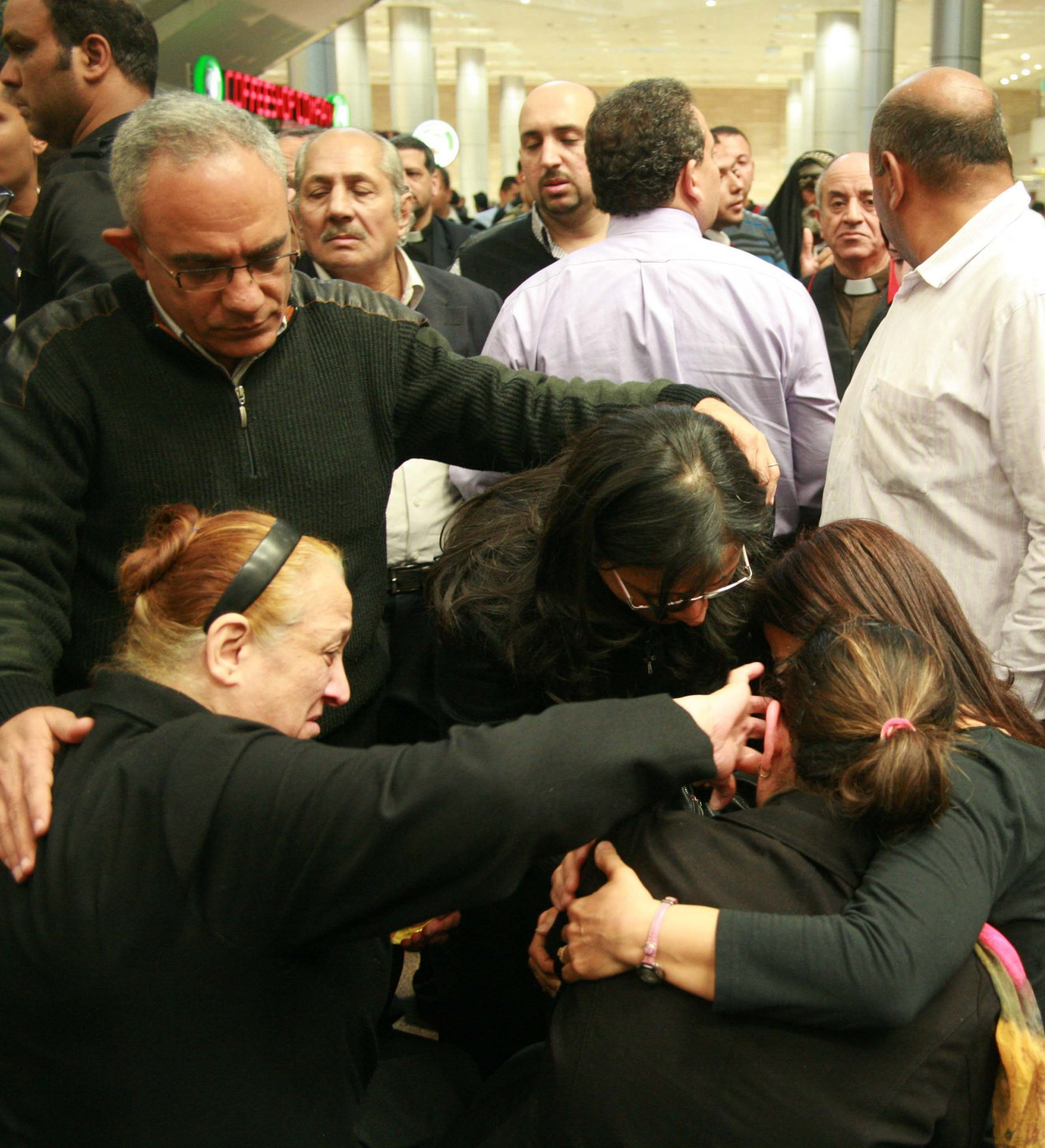 Ezzat Hakim Atallahs Widow Ragaa Abdallah With Ponytail Collapses Grief Upon Arrival To Airport In Cairo Morning Star News Photo
