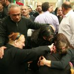 Ezzat Hakim Atallah's widow, Ragaa Nagah (with ponytail), collapses with grief upon arrival to airport in Cairo. (Morning Star News photo)