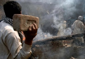 Police only looked on as homes, shops and churches were destroyed in Lahore. (M. Ali photo)