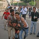 A Coptic Christian hurt in attack on mourners Sunday. (Morning Star News photo)