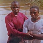 A photo of the Rev. James Danladi Mahwash baptizing Jamle Benjamin Sunday, who was killed in the attack in Mile Bakwai, Nigeria. (Morning Star News photo)