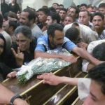 Mourners at funeral for four Copts on Sunday (July 7). (Morning Star News photo)