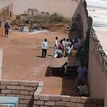 Plain-clothes police enter church building with NISS personnel. (Morning Star News)