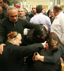 Ezzat Hakim Atallah's widow, Ragaa Abdallah (with ponytail) collapses with grief upon arrival to airport in Cairo. (Morning Star News)