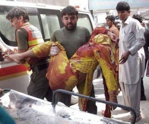 Woman injured in attack on church in Peshawar, Pakistan. (Morning Star News)