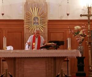 The Rev. Roberto Ferrari prepares to administer Holy Communion at St. Stephanos Church in Istanbul, Turkey. (Morning Star News)