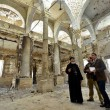 Rights activist Mina Thabet (center) and others examine church building set ablaze on Aug. 14, 2013. (Morning Star News)