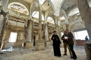 Rights activist Mina Thabet (center) and others examine church building set ablaze on Aug. 14, 2013. (Courtesy of Mina Thabet)