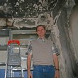 David Byle amid fire damage at Bible Correspondence Course in Turkey