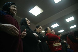 Iraqis pray at mass observed in office complex in Erbil converted to house about 350 families. (Morning Star News)