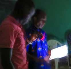 A pastor leads a Christian meeting by flashlight at damaged church building in Niamey, Niger. (RUN International).jpg
