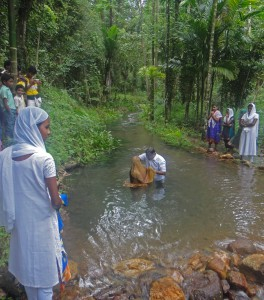 Baptism of a convert to Christianity at an undisclosed viillage in India. (Christian Aid Mission)