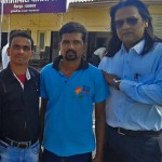 Pramod Sahu (center) was attacked at his workplace. (Morning Star News)