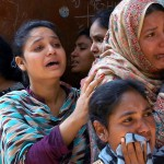 Christian women mourn a dead relative after church bombings in Lahore. (M. Ali)