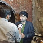 Sarfraz William of Gawahi cable TV channel is interviewed following fire at station office. (Morning Star News via Gawahi Facebook)