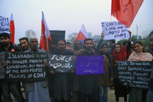 Awami Workers' Party members and Christian slum dwellers protest eviction in Islamabad on Dec. 8. (AWP)
