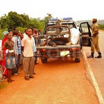 Police collect the body of Ismail Kuloba. (Morning Star News)