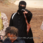 Islamic State executioner in Libya addresses viewers in video. (Screen-save Morning Star News)