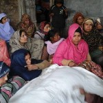Loved ones keep vigil over the body of Liaqat Masih at home. (Morning Star News)