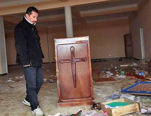 Pastor Mustapha Krireche surveys damage to Light Church in Tizi-Ouzou, Algeria. (Morning Star News)