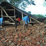 Workers sift through rubble of demolished church building in Nalugondo, Uganda. (Morning Star News)