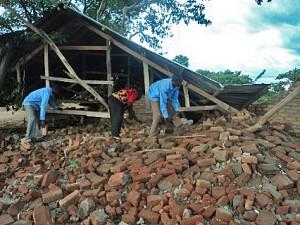 Workers sift through rubble of demolished church building in Nalugondo, Uganda. (Morning Star News)