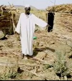 A relative of two children killed on May 1 in Heiban points to the site where a government bomb hit. (Nuba Reports)