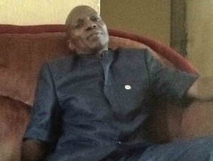 Pastor Olawale Elisha speaks of his slain wife in his home in suburb of Abuja. (Morning Star News)
