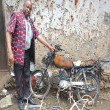 Pastor Damson Maonesho and damaged motorbike near Zanzibar City. (Morning Star News)