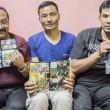 Bimal Shahi, Prakash Pradhan and Shakti Pakhrin, three of eight Christians acquitted, with The Great Story comic book. (CSW, Giulio Paletta)