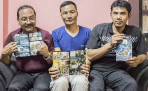 Bimal Shahi, Prakash Pradhan and Shakti Pakhrin, three of eight Christians acquitted, with The Great Story comic book. (CSW, Giulio Paletta)
