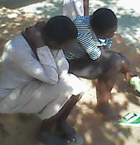 Two daughters, 22 and 17, mourn the death of their father, Yokannah Zirinkuma in Uganda. (Morning Star News)