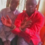 Hassan Muwanguzi (handcuffed) with accuser Nghangha Mubakali during police investigation to stir up Muslim hostility. (Morning Star News)