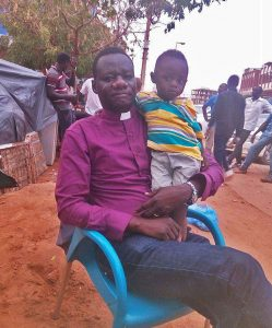 The Rev. Yahia Nalu and his son, living on the street. (Morning Star News)