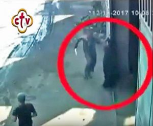 Assailant arriving at warehouse door in pursuit of Coptic Orthodox bishop on outskirts of Cairo, Egypt. (Screen grab of security footage)