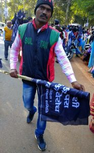 Tribal activist carrying black flag the day before Christmas in Jharkhand state, India. (Morning Star News)