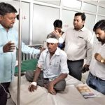 Christian leaders pray for Ram Prasad, wounded in church attack in Uttar Pradesh state, India. (Morning Star News)