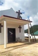 A United Wa State Army (UWSA) militant begins toppling cross on church building in rebel-held territory in Shan state, Burma (Myanmar), in photo circulated on Facebook. (Morning Star News)