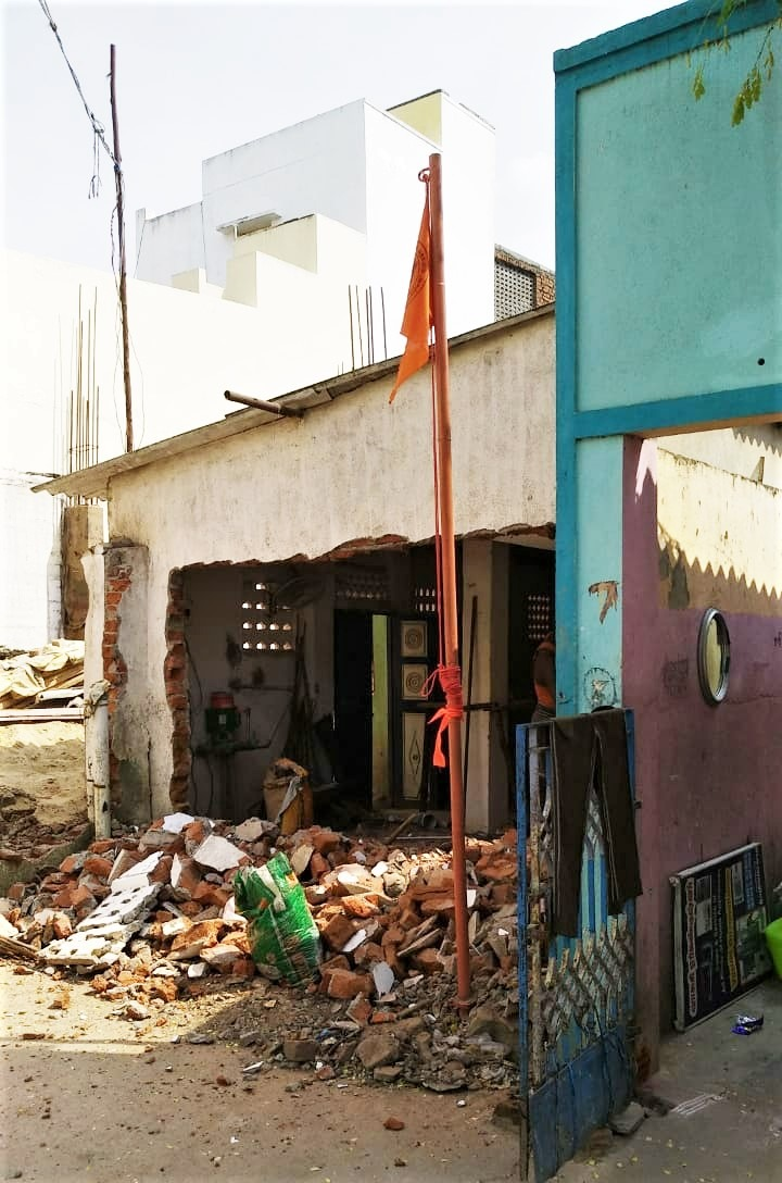 Saffron flag erected by Hindu extremists at half-constructed