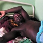Samuel Wah in hospital in Miango, Nigeria, nearly three months after Muslim Fulani herdsmen shot him. (Morning Star News)