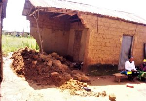 The displaced Gado family lives in the open air in room destroyed by rains. (Morning Star News)