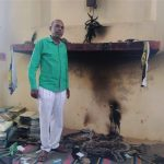Pastor Anil Juit amid charred debris at church building in Arrah, Bihar state, India. (Morning Star News)