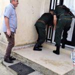 Pastor Messaoud Talkit watches as gendarmes seal church building in Lekhmis village, Algeria on Aug. 6, 2019. (Morning Star News)
