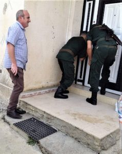 Pastor Messaoud Talkit watches as gendarmes seal church building in Lekhmis village, Algeria on Aug. 6, 2019. (Morning Star News)