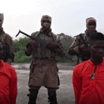 Screen capture from Islamic State's Amaq news site of Christian aid workers Godfrey Ali Shikagham (left) and Lawrence Duna Dacighir, before their execution by Boko Haram.